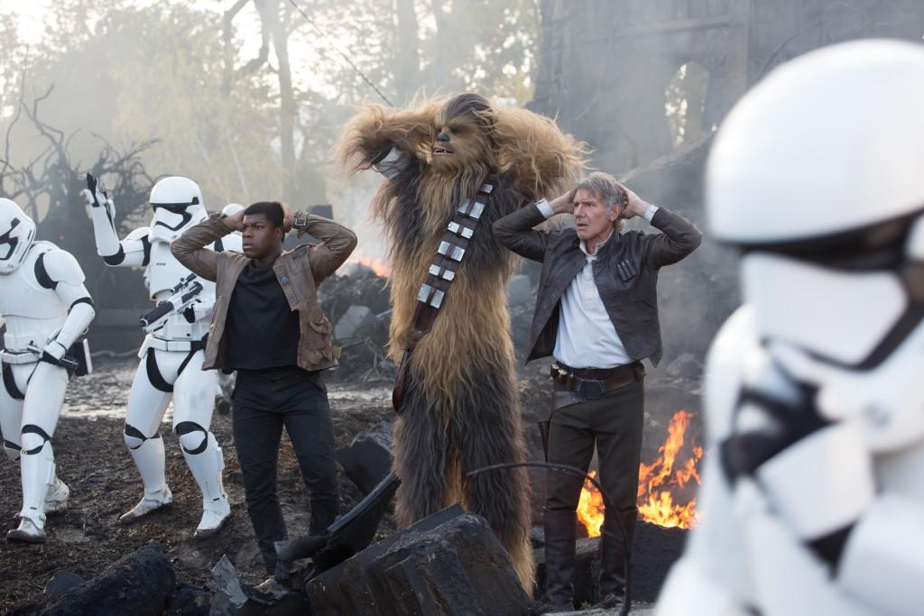 Star Wars: The Force Awakens..L to R: Finn (John Boyega), Chewbacca (Peter Mayhew), and Han Solo (Harrison Ford)..Ph: David James..? 2015 Lucasfilm Ltd. & TM. All Right Reserved.