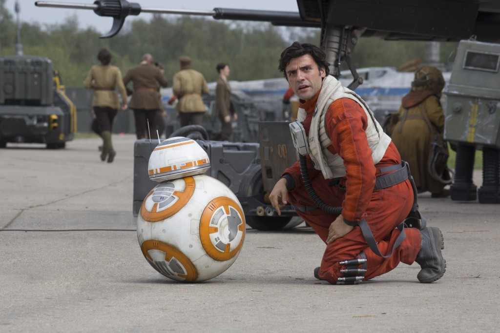 Star Wars: The Force Awakens..L to R: BB-8 and Poe Dameron (Oscar Isaac)..Ph: David James..? 2015 Lucasfilm Ltd. & TM. All Right Reserved.
