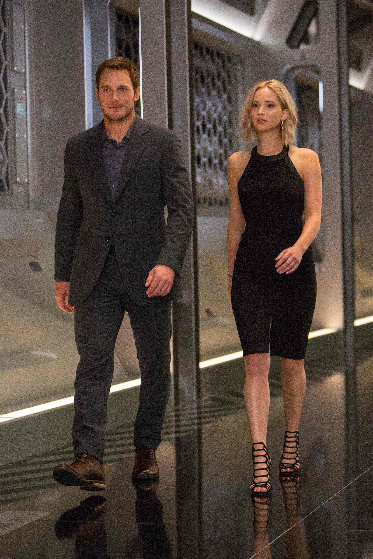 Jim (CHRIS PRATT) and Aurora (JENNIFER LAWRENCE) walk thru the Hibernation Bay on date night in Columbia Pictures' PASSENGERS