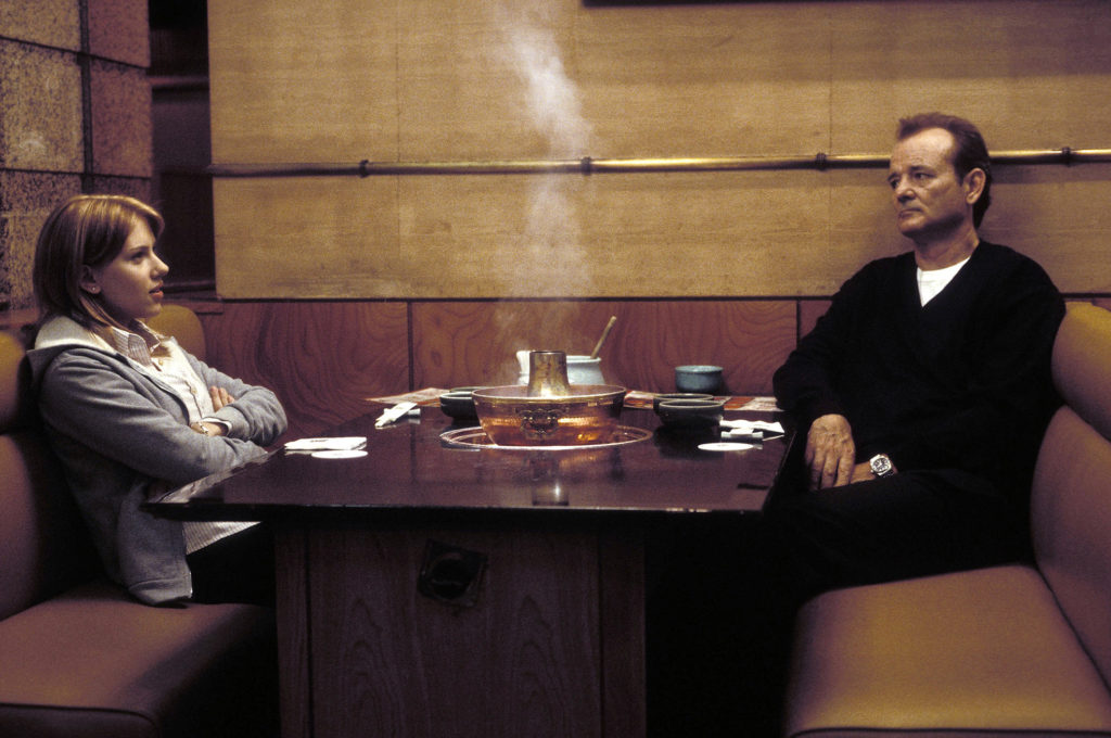 """Actor Bill Murray, right, and Scarlett Johansson star in Sofia Coppola's """"Lost In Translation,"""" in this undated promotional photo. The Motion Picture Association of America and top studios want to ban DVD and videotape screeners sent to Academy Awards voters of films competing for Oscar nominations. Studio and MPAA leaders say the move is an attempt to fight piracy, but studio-owned boutique banners such as Focus Features, Miramax and Sony Pictures Classics say the ban would undermine the prospects fortheir films to snag Oscar nominations. (AP Photo/Yoshio Sato, Focus Features)"""